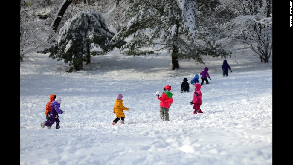 Children play in the snow Tuesday, February 4, in New York's Central Park.