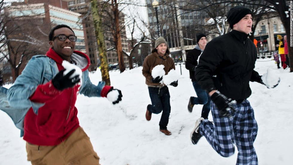 People run before throwing snowballs in the Dupont Circle neighborhood of Washington on February 13.