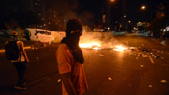 Students clash with riot police in Caracas as they protest against the government of Venezuelan President Nicolas Maduro.