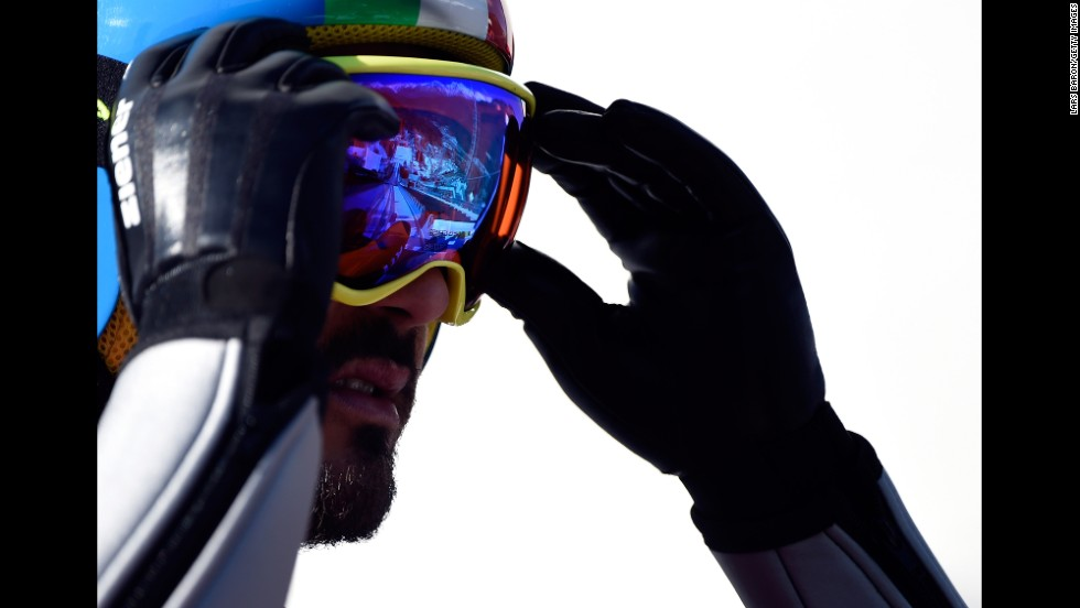 Giuseppe Michielli of Italy adjusts his goggles February 15 during training for the large hill Nordic combined event.