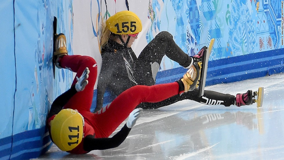 China's Alang Ki, in red, and the USA's Emily Scott crash into the wall after colliding during the finals of the women's 1,500-meter  short track speedskating race on February 15.