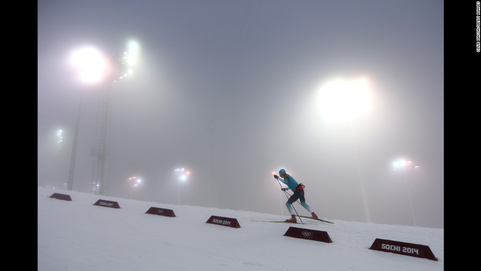 A biathlete warms up for the men's 15-kilometer mass start event on February 16.