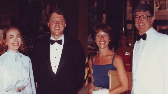 Hillary and Bill Clinton with Diane and Jim Blair at a formal event.