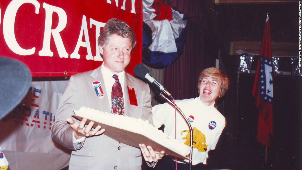 Diane Blair looks amused as Bill Clinton holds a cake at a 1988 Democratic event in Washington County, Arkansas.