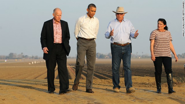 President Barack Obama (2nd-L) walks with California Governor Jerry Brown (L), Joe and Maria Del Bosque (R) of Empresas Del Bosque farm, addressing California's drought situation Friday, Feburary 14, 2014 in Los Banos, CA.
