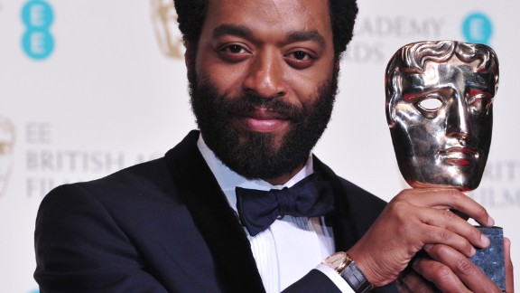 British actor Chiwetel Ejiofor poses with the award for a leading actor for his work on the film
