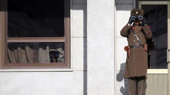 A North Korean soldier uses binoculars on Thursday, February 6, to look at South Korea from the border village of Panmunjom, which has separated the two Koreas since the Korean War.
