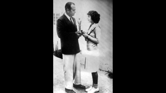 "Janet Gaynor (1929): Douglas Fairbanks Sr. hands Janet Gaynor her best actress Oscar in 1929 for Gaynor's performance in the 1927 film ''Sunrise."" It was the first best actress Oscar ever awarded."