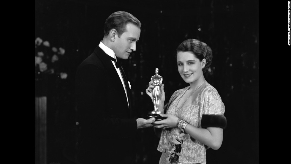 "Norma Shearer receives a best actress Oscar in October 1930 for her role in ""The Divorcee."" Giving her the award is Conrad Nagel, who starred with her in the film released earlier that year."