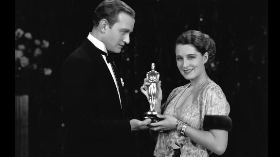 """<strong>Norma Shearer (1930):</strong> Norma Shearer receives a best actress Oscar in October 1930 for her role in """"The Divorcee."""" Giving her the award is Conrad Nagel, who starred with her in the film released earlier that year."""