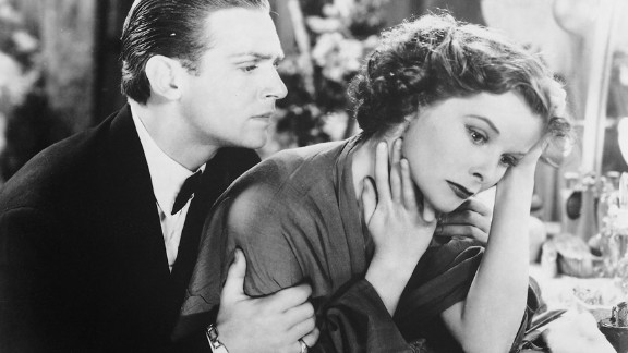 """<strong>Katharine Hepburn (1934):</strong> Douglas Fairbanks Jr. and Katharine Hepburn appear in the 1933 film """"Morning Glory."""" Hepburn's performance earned her the best actress Oscar in 1934. There was no Academy Awards ceremony in 1933; films from that year and the last half of 1932 were eligible to win at the 1934 ceremony."""