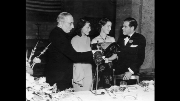 """<strong>Luise Rainer (1937):</strong> Luise Rainer, second from left, is seen at the 1937 ceremony with, from left, Louis B. Mayer, Louise Tracy and Frank Capra. Rainer won for """"The Great Ziegfeld."""""""