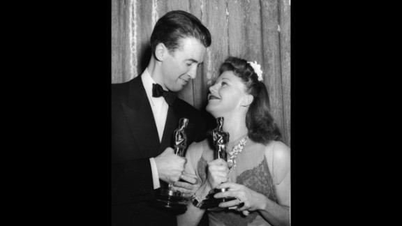 """<strong>Ginger Rogers (1941):</strong> Actors James Stewart and Ginger Rogers smile after winning Oscars in 1941. Stewart won best actor for his performance in """"The Philadelphia Story,"""" while Rogers won best actress for her performance in """"Kitty Foyle: The Natural History of a Woman."""""""