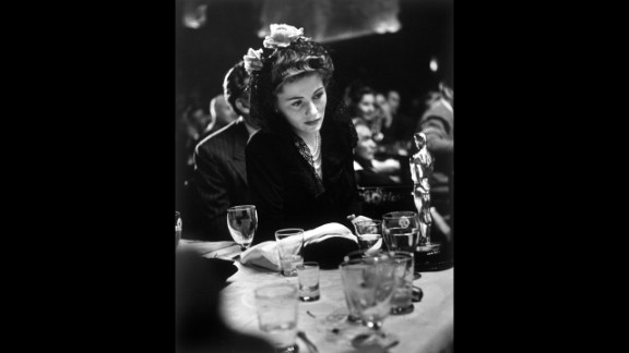 """<strong>Joan Fontaine (1942):</strong> Joan Fontaine looks at the best actress Oscar she won for her role in the film """"Suspicion."""""""
