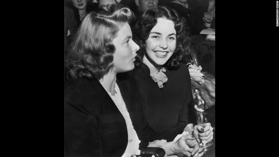 "Jennifer Jones holds the best actress Oscar she won in 1944 for her performance in ""Song of Bernadette."" To her right is actress Ingrid Bergman."