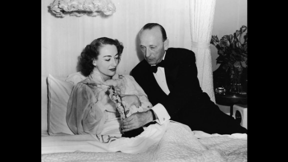 """<strong>Joan Crawford (1946):</strong> Joan Crawford receives her Academy Award in bed because of an illness. She was recognized for her performance in the 1945 film """"Mildred Pierce."""""""