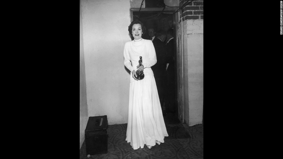 "Jane Wyman stands by a doorway backstage at the Academy Awards. She won her best actress Oscar for the film ""Johnny Belinda."""