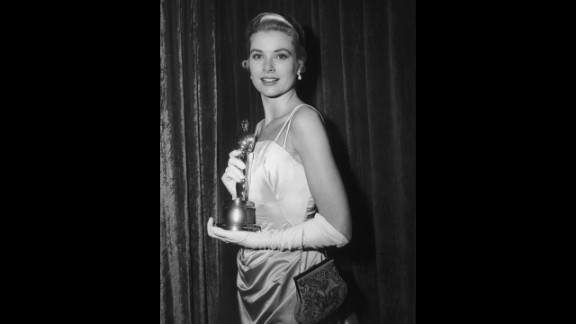 """<strong>Grace Kelly (1955):</strong> Grace Kelly poses with her Oscar after the Academy Awards ceremony in 1955. She won the statuette for her role in """"The Country Girl."""""""