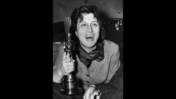 """<strong>Anna Magnani (1956):</strong> Anna Magnani enthusiastically holds the Oscar she won for """"Rose Tattoo."""" The award was presented to her by U.S. Ambassador Clare Luce at the Villa Taverna in Rome."""