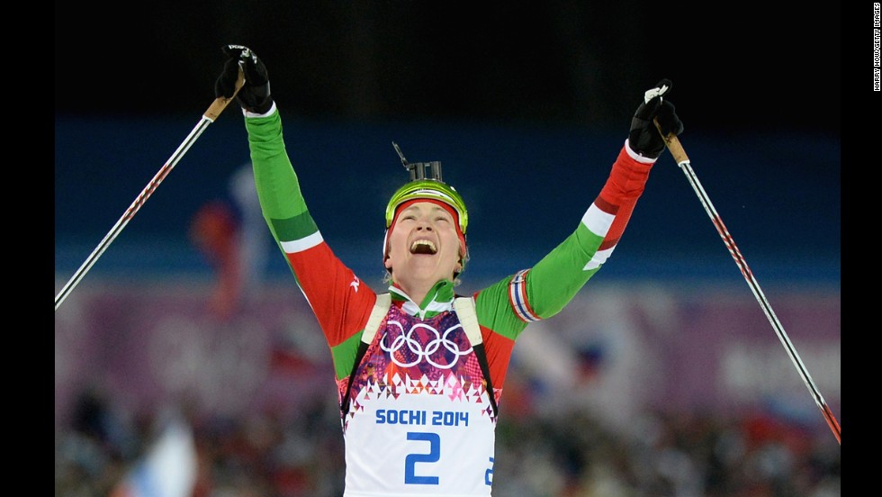 Belarussian biathlete Darya Domracheva celebrates winning the women's 12.5-kilometer mass start event on February 17.
