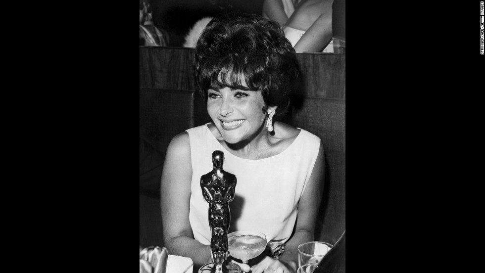 "Elizabeth Taylor is seen with her Oscar after being named best actress for her part in ""Butterfield 8."""