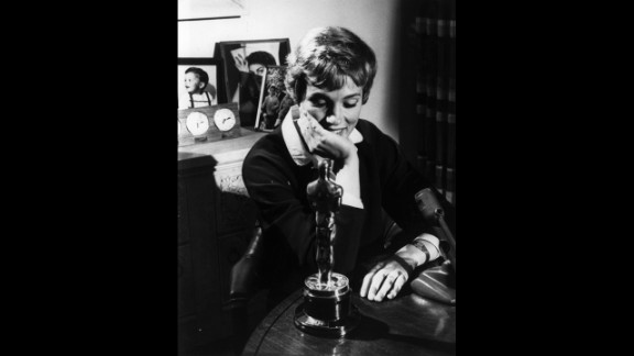 """<strong>Julie Andrews (1965): </strong>Julie Andrews looks at the Academy Award she won for """"Mary Poppins'"""" in 1965. The role was her film debut."""