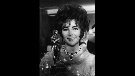 """<strong>Elizabeth Taylor (1967):</strong> Elizabeth Taylor holds up her second Oscar, this one for the film """"Who's Afraid of Virginia Woolf."""""""