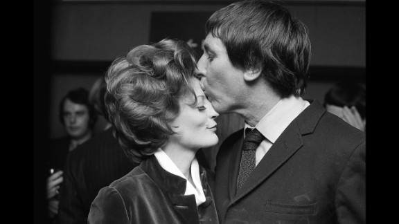 """<strong>Maggie Smith (1970):</strong> Maggie Smith, who won for """"The Prime of Miss Jean Brodie,"""" celebrates with her husband at the time, Robert Stephens."""
