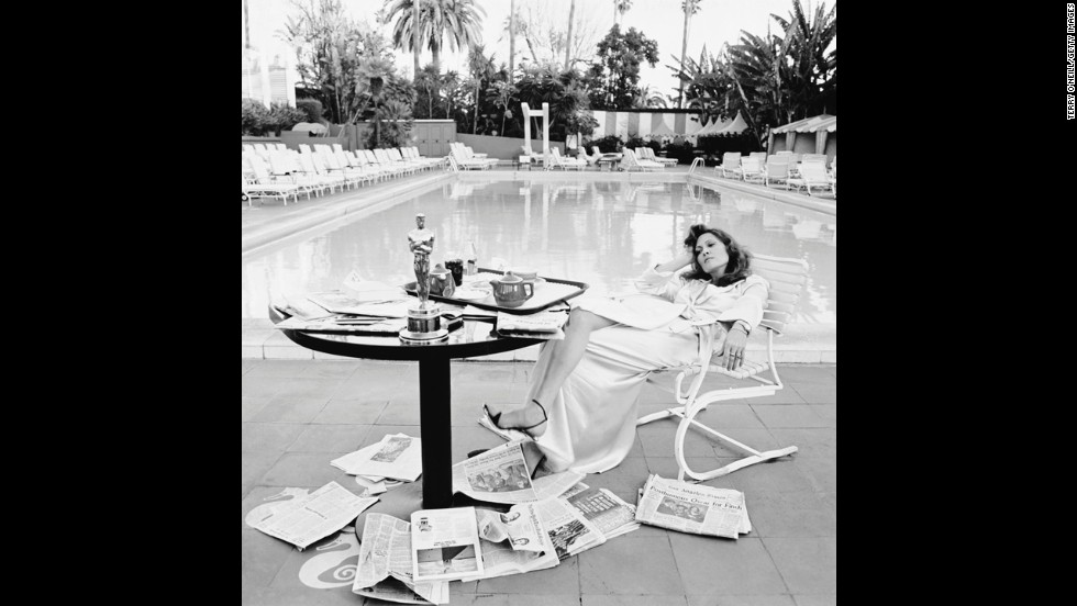 "Faye Dunaway rests by the Beverly Hills Hotel swimming pool the morning after she received the best actress Oscar for ""Network."""