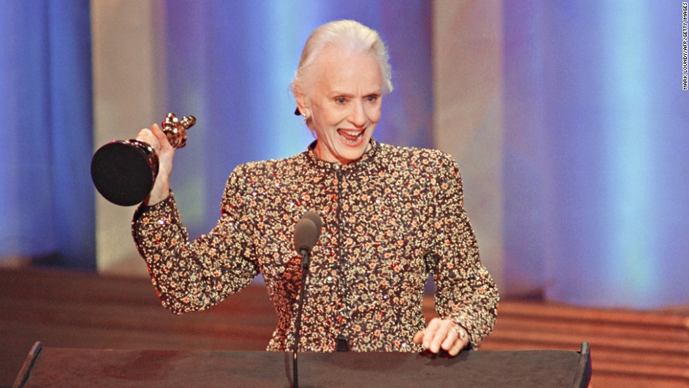 "Jessica Tandy acknowledges applause after receiving the Oscar for her role in ""Driving Miss Daisy."""