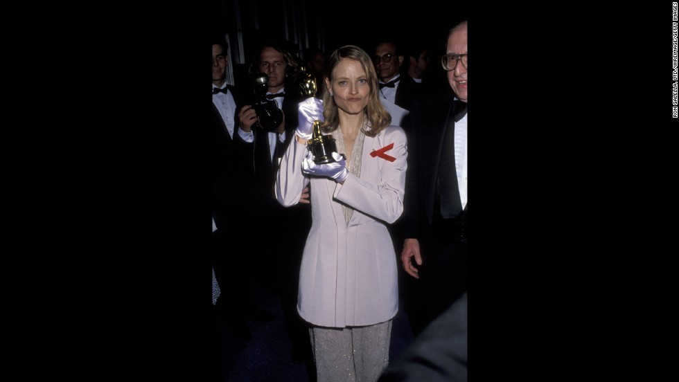 "Jodie Foster holds up her second Oscar, this one for her role in ""The Silence of the Lambs."""