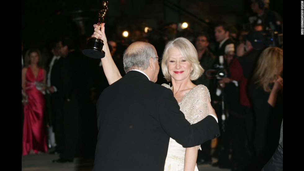 "Director Taylor Hackford kisses his wife, Helen Mirren, after Mirren won the best actress Oscar for her role in ""The Queen."""