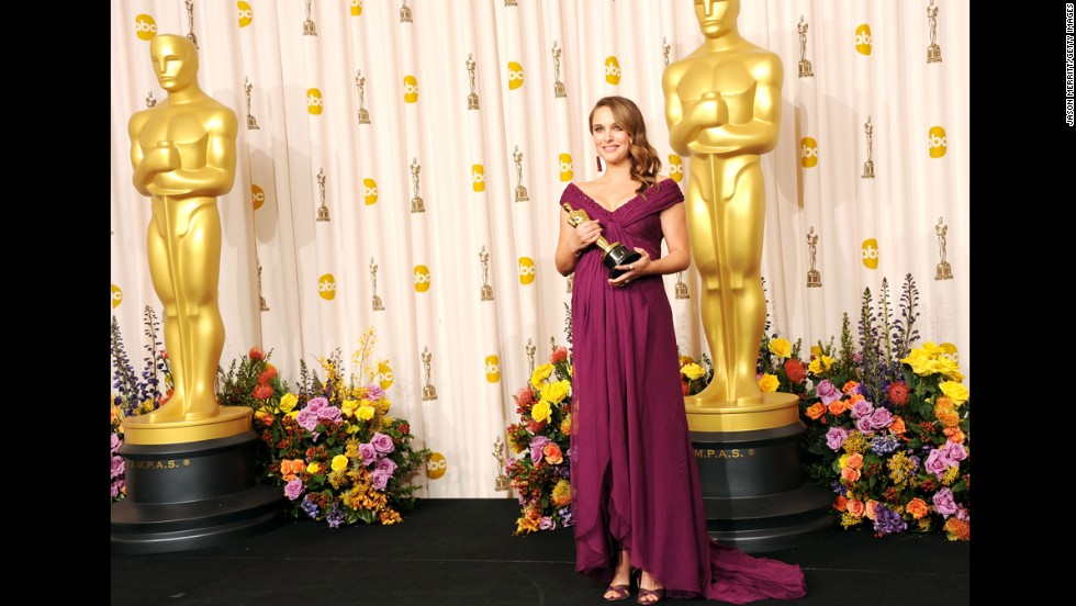 "Pregnant or not, actress Natalie Portman was ready to collect her best actress Oscar for ""Black Swan"" at the 2011 Oscars. The fact that she did so in a violet, exceptionally tailored Rodarte gown was the icing on a very gilded cake."