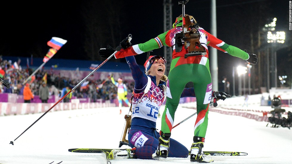 Gold medalist Darya Domracheva, right, of Belarus celebrates with bronze medalist Tiril Eckhoff of Norway after the women's 12.5-kilometer mass start event on February 17.