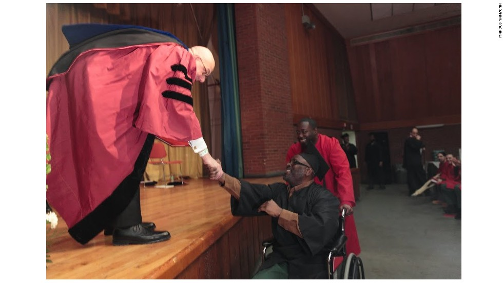 Botstein shakes a graduate's hand.
