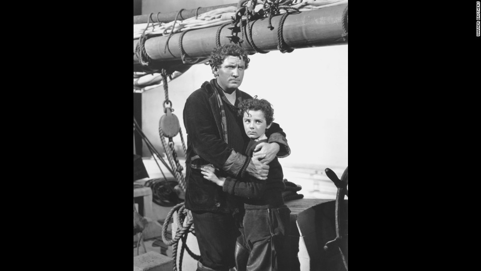 "Spencer Tracy, left, with co-star Freddie Bartholomew, won his first best actor Oscar as a Portuguese fisherman in ""Captains Courageous.""  He beat out Oscar-winning actors Fredric March in ""A Star Is Born"" and Paul Muni in ""The Life of Emile Zola.""  It was Tracy's second nomination."