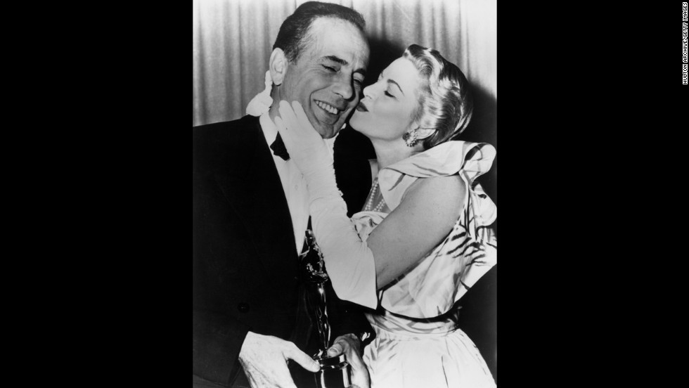 "Claire Trevor can't resist giving Humphrey Bogart a kiss backstage at the 1952 Oscars ceremony after he won the best actor award for ""The African Queen."" Bogart beat out Marlon Brando in ""A Streetcar Named Desire,"" Fredric March in ""Death of a Salesman"" and Montgomery Clift in ""A Place in the Sun."""