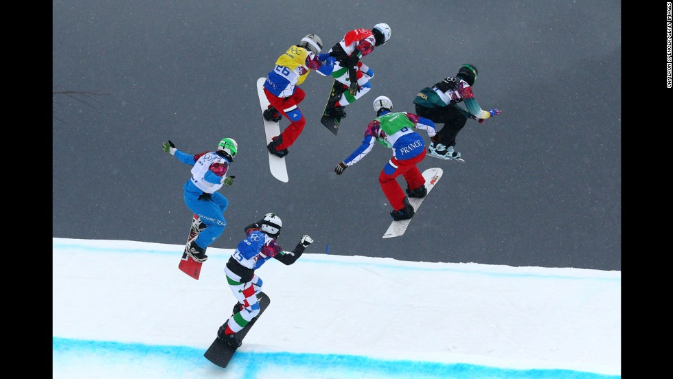 Athletes compete February 18 in a snowboard cross semifinal.