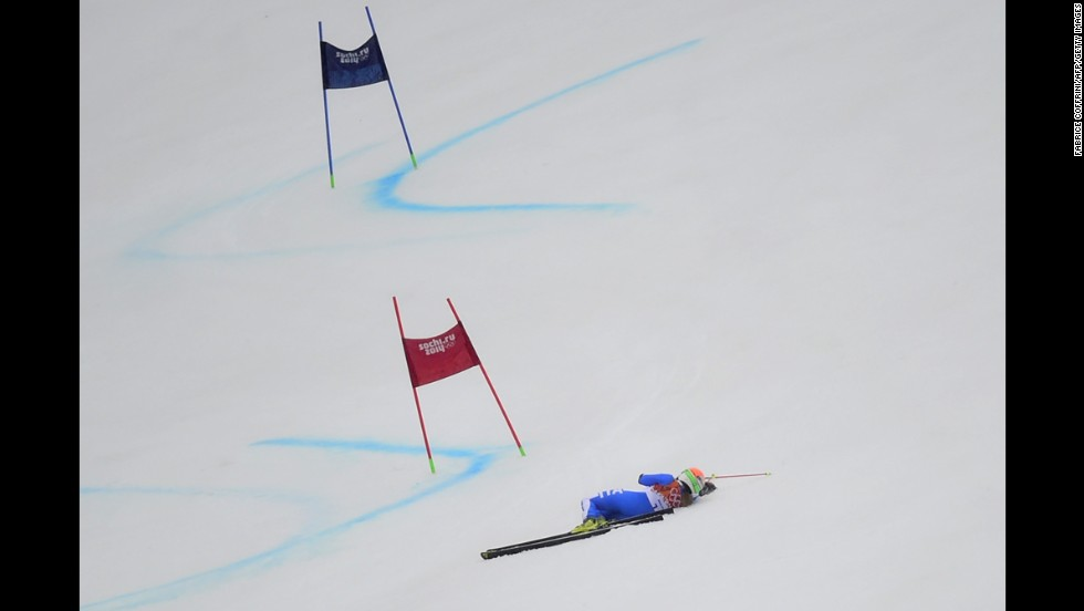 Italy's Denise Karbon lies on the slope after falling during the women's giant slalom on February 18.