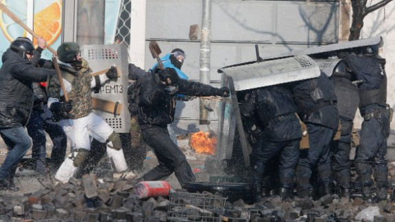 Protesters clash with riot police outside Ukraine
