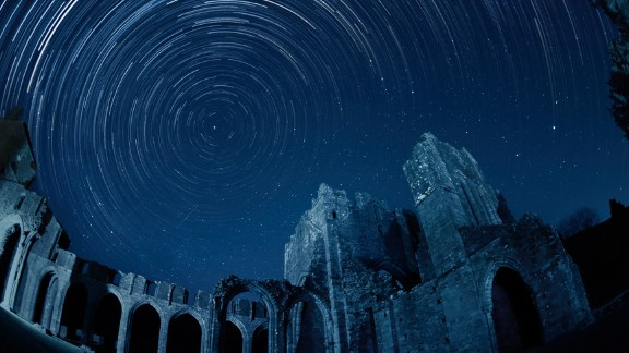 """<strong>Brecon Beacons National Park (UK): </strong>Stargazers in the UK can enjoy the silhouette of the Llanthony Priory against the starry sky. The ruins have partly been <a href=""""http://www.llanthonyprioryhotel.co.uk/"""" target=""""_blank"""" target=""""_blank"""">converted into a pub</a>.  After a night of hard sky observation, you can step into the former Augustinian priory for an authentic Welsh ale."""