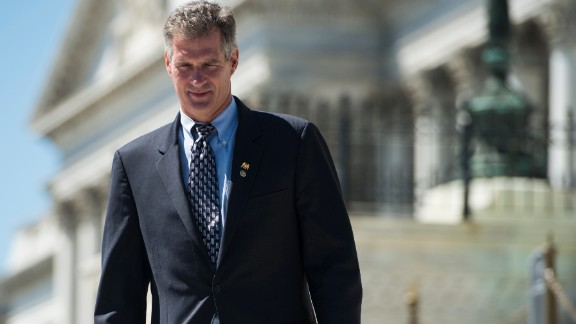 UNITED STATES - JULY 25: Sen. Scott Brown, R-Mass., waits to pose for photos on the Senate steps on Wednesday, July 25, 2012. (Photo By Bill Clark/CQ Roll Call)