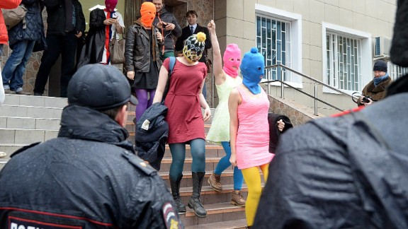 Wearing mask members of Russian punk group Pussy Riot, Nadezhda Tolokonnikova (R) and Maria Alyokhina (2dR) walk by journalists while leaving the police station of Adler, near Sochi, on February 18, 2014 after her arrest earlier in the host city of the 2014 Winter Olympics. Tolokonnikova and Alyokhina walked free after being questioned about an alleged theft from a hotel. AFP PHOTO / ANDREJ ISAKOVICANDREJ ISAKOVIC/AFP/Getty Images