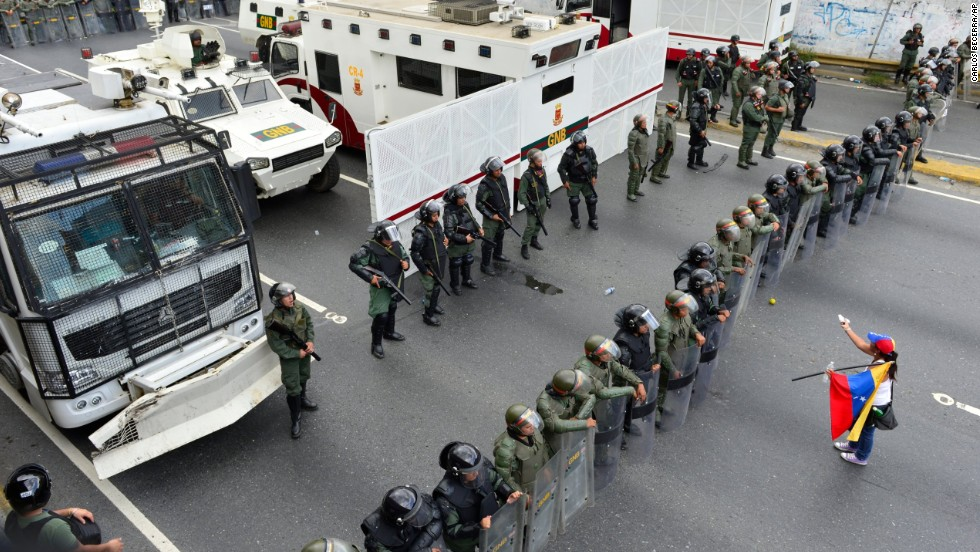 A protester confronts the National Guard as they block the path leading to downtown Caracas on February 18.