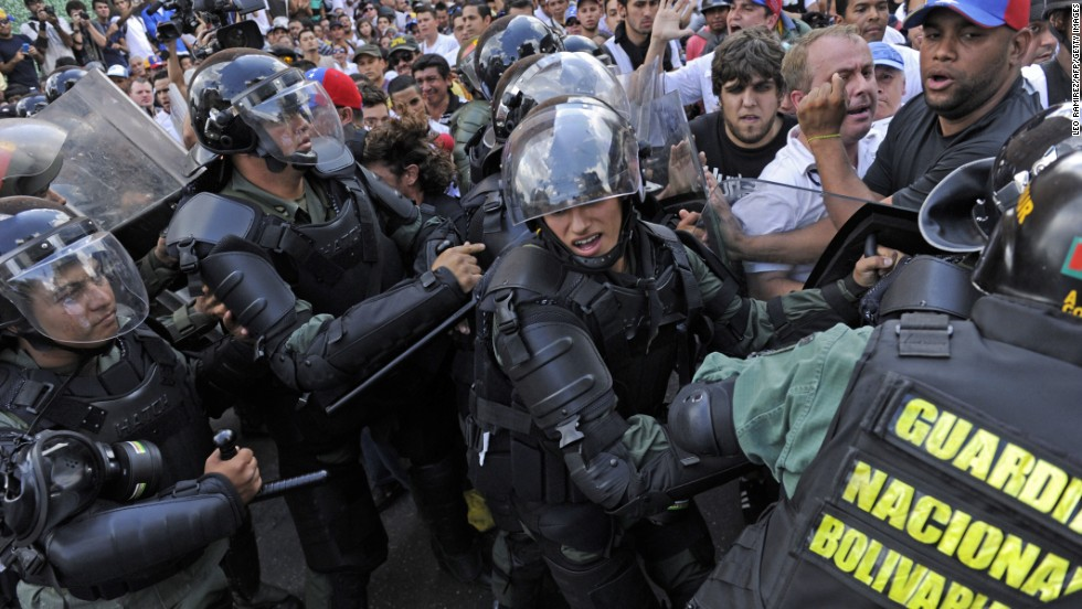 Protesters clash with the National Guard during demonstrations in Caracas on February 18.