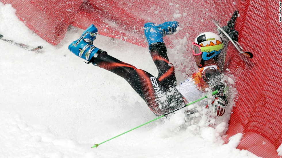 Spain's Alex Puente Tasias crashes in the first run of the men's giant slalom.