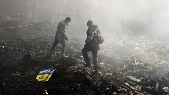Protesters walk in the rubble of Independence Square on February 19.