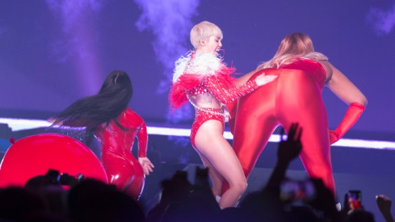 """In April 2014, Cyrus was doing her thing on stage when a fight broke out between fans at a show in Detroit. Cyrus reportedly took time out to record the two women and post the video to her Instagram, where she could be heard yelling """"Catfight!"""""""
