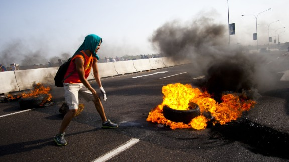 The images of the Venezuela protests spreading online have been a mix of truths and half-truths, with some actually showing other world events. In this verified image, a student in Maracaibo lights a tire on fire on February 15. Note: The images in this gallery may be disturbing to some. (This gallery has been updated to include examples of photo manipulation by the government, in addition to the Venezuelan opposition.)