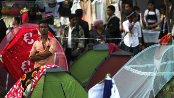 """Protesters stand near their tents in Bangkok, where they have been camping out since November 2013. """"The atmosphere was peaceful ... though some tension was to be read from the protestors' faces,"""" Kowalska said."""